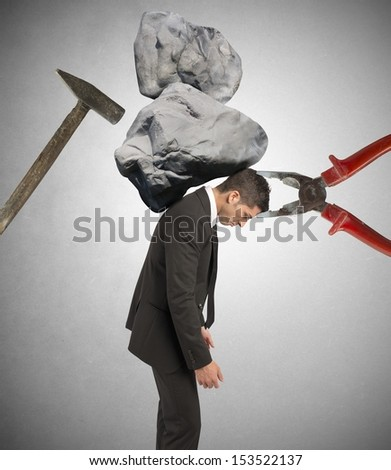 Stress concept of a businessman at work - stock photo