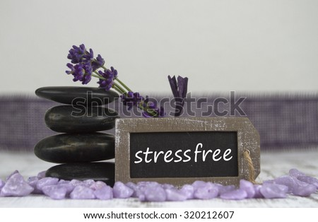 stress free with hot stones and lavender - stock photo