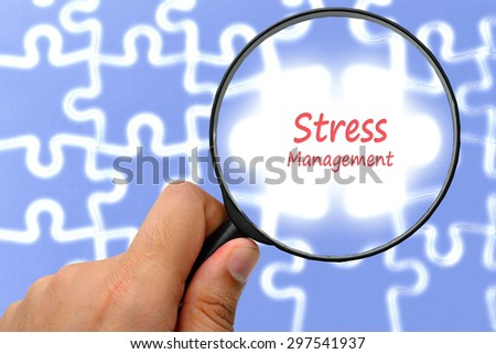 Stress management word. Magnifier and puzzles. - stock photo