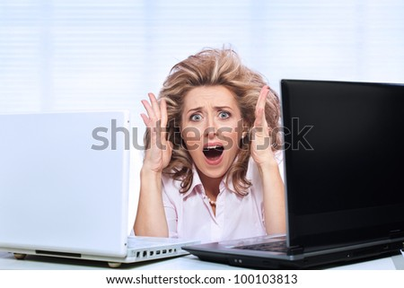 Stress / Too much work for one office worker - stock photo