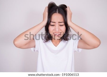 Stress. Woman stressed is going crazy pulling her hair in frustration - stock photo