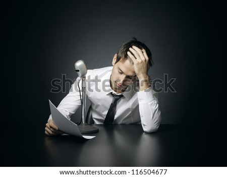 Stressed anchorman reads the news - stock photo