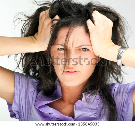Stressed angry woman portrait - stock photo