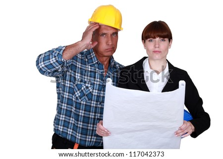 Stressed architect and foreman - stock photo