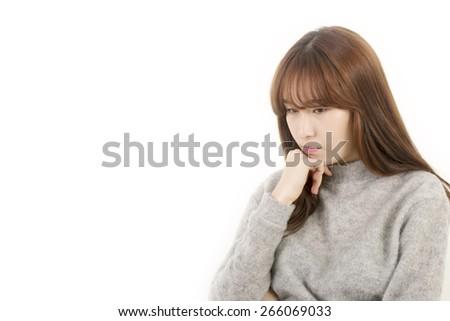 Stressed asian female student - stock photo