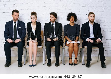 Stressed business people waiting for job interview - stock photo