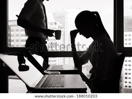 Stressed business woman in the office. - stock photo