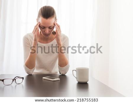 Stressed business woman in the office - stock photo