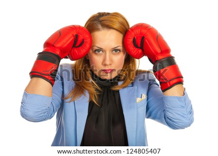 Stressed business woman standing with hands in boxing gloves to head isolated on white background - stock photo