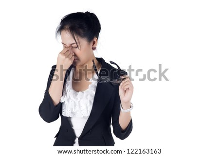 Stressed business woman with a headache isolate on white background, Model is Asian woman. - stock photo