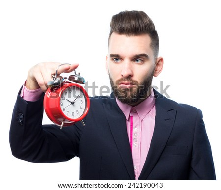 Stressed businessman holding a clock   - stock photo