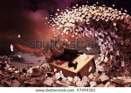Stressed businessman in a bureaucracy sea, made of papers - stock photo