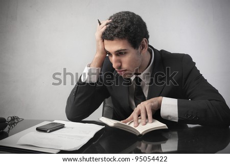 Stressed businessman making a financial plan - stock photo