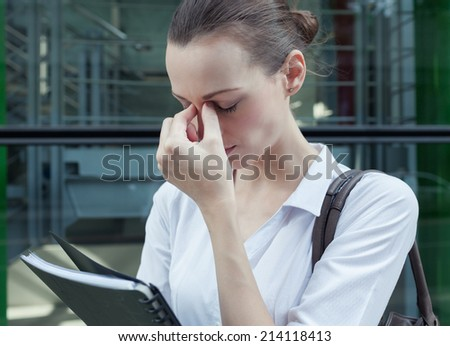 Stressed businesswoman - stock photo