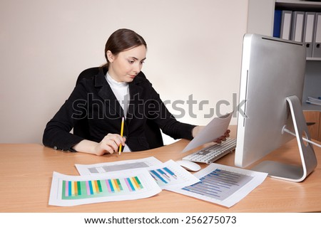 Stressed businesswoman looking  on documents badly - stock photo