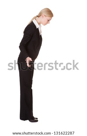 Stressed businesswoman ready to jump. Isolated on white - stock photo