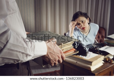 Stressed businesswoman with a too much paperwork and documents - stock photo