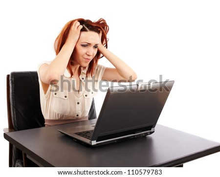 Stressed caucasian redhead woman at her computer - stock photo