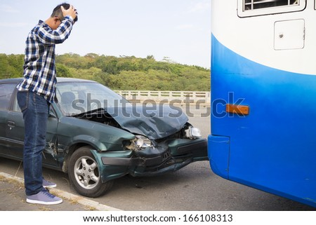 Stressed Driver looking at car After Traffic Accident on the road - stock photo