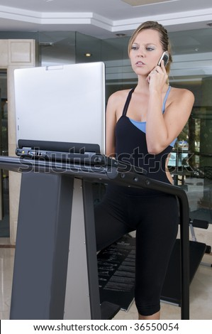 stressed executive woman doing exercise and working with lap top - stock photo