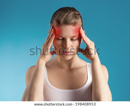 Stressed female having migraine shown with red spots.   - stock photo