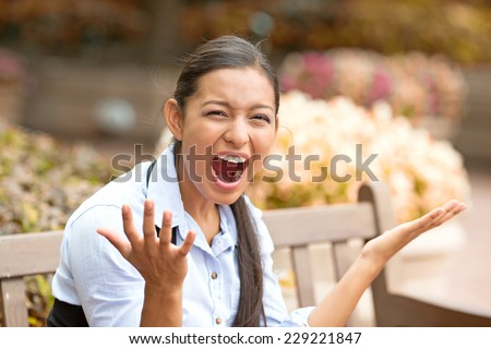 stressed frustrated young woman screaming having nervous breakdown isolated outside street park background. Negative human emotion face expression feeling. long working hours concept - stock photo