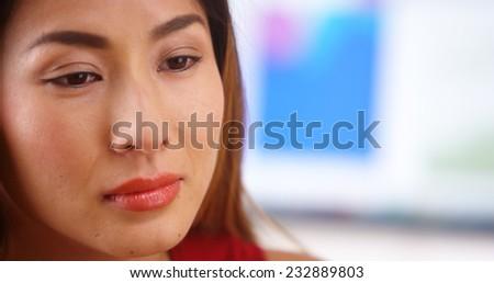 Stressed Japanese businesswoman - stock photo