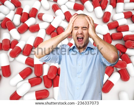 stressed man and pill background - stock photo