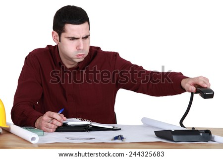 Stressed man hanging up the phone - stock photo