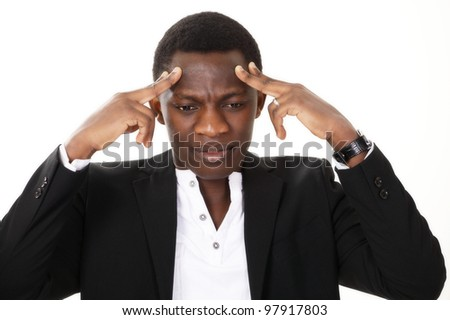 Stressed man holding head - stock photo