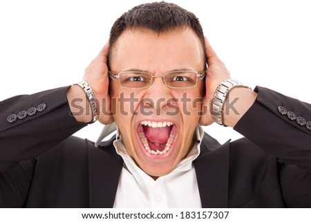 stressed man screaming holding his head with expression - stock photo