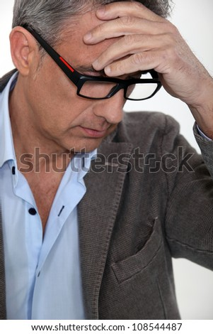 Stressed middle-aged businessman - stock photo