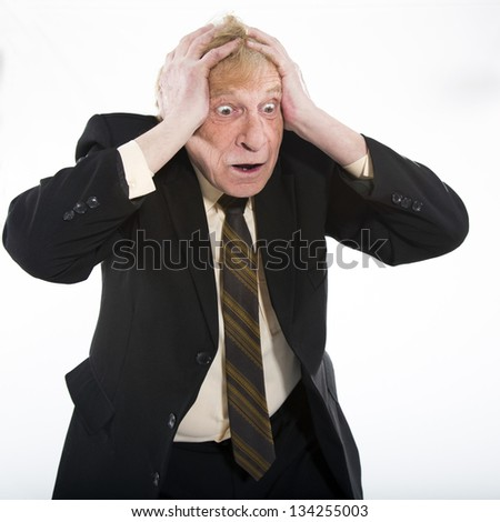 Stressed old business man white background - stock photo