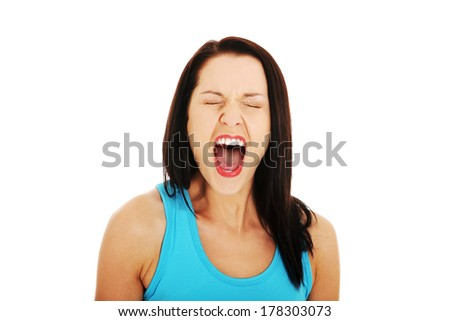 Stressed or angry woman screaming loud  - stock photo