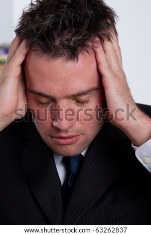 Stressed out businessman not being able to work anymore. - stock photo