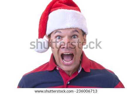 Stressed out Caucasian man wearing red Santa hat screams in disbelief on white background - stock photo