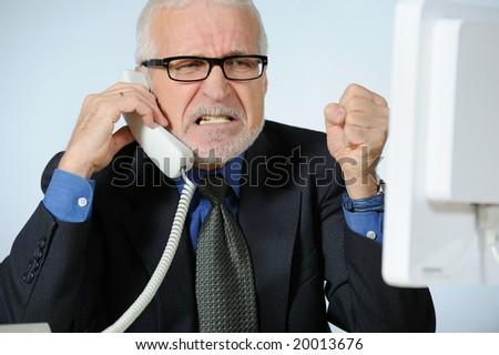 Stressed senior businessman - stock photo