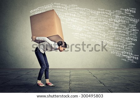 Stressed woman carrying on her back shoulders large box  - stock photo