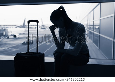 Stressed woman in the airport. - stock photo