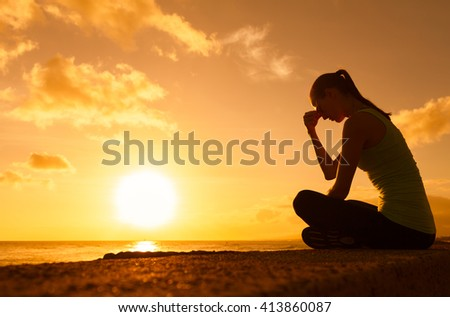 Stressed woman sitting alone outdoors.  - stock photo