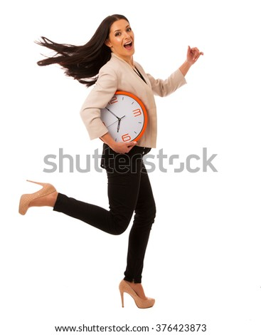 Stressed woman with big clock rushing because of being late. - stock photo