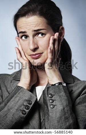 Stressed young business woman having a migraine. - stock photo