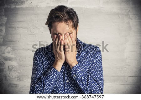 Stressed young businessman - stock photo