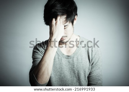 Stressed young man - stock photo