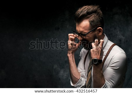 Stressed young man screaming - stock photo
