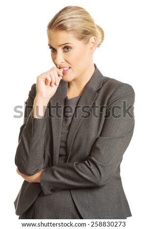Stressed young woman biting her nails. - stock photo