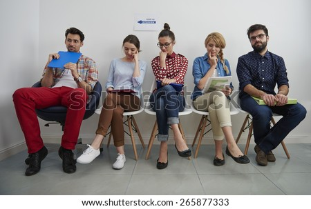 Stressful moments for people in the queue - stock photo