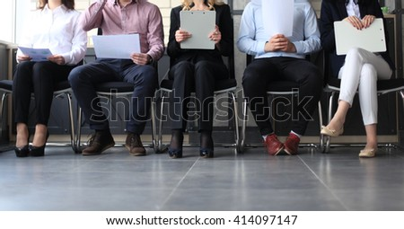 Stressful people waiting for job interview - stock photo