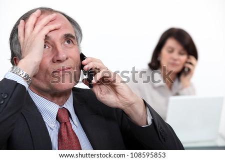 Stressful telephone call - stock photo