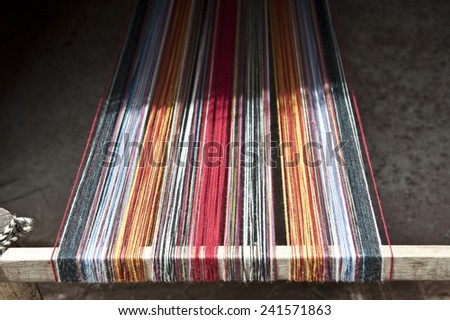 Stretched alpaca yarn being prepped for making clothing. - stock photo